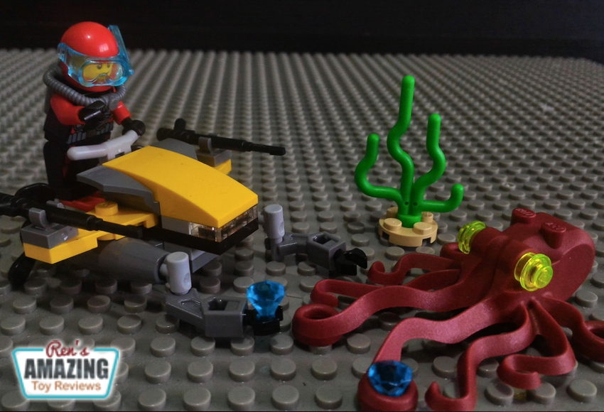 Features a scuba scooter with spinning propellers, 2 robotic arms and 2 harpoons, octopus, seaweed and 2 crystals